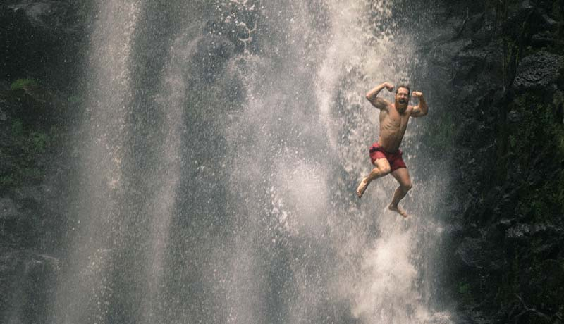 Physical Conditions - man jumping at waterfall
